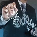 Businessman hand show gear to success — Stock Photo #18056805