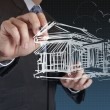 Businessman draws building development — Stock Photo #18057031