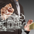 Businessman draws building development - Stock Photo