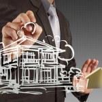 Businessman draws building development — Stock Photo #18058075