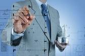 Businessman draws building development — Stock Photo