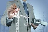 Affärsman ritar byggnaden utveckling — Stockfoto