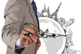 Businessman draws dream travel around the world — Stock Photo