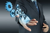 Businessman hand show gear to success — Stock Photo