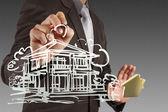 Biznesmen rysuje budowy — Zdjęcie stockowe