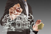 Businessman draws building development — Stockfoto
