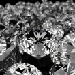 Diamonds on black surface - Stock Photo