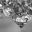 Diamonds on black surface — Stok fotoğraf