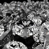 Diamanter på svart yta — Stockfoto
