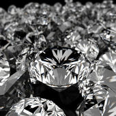 Diamonds on black surface — Stock Photo