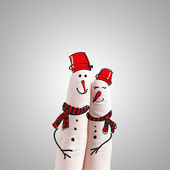 A lovely couple hand drawn and finger,snowmen — Stock Photo