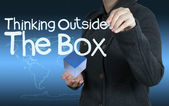 Word thinking outside the box as concept — Stock Photo