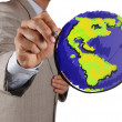 Stock Photo: Businessman hand drawing abstract globe