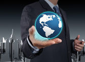 A glowing earth globe in his hands — Stock Photo