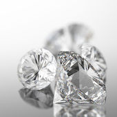 Diamonds on black surface — Stock Photo