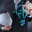Engineer drawing lightbulb and construction — Stock Photo