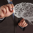 Businessman hand drawing a brain — Stock Photo