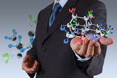 Businessman holding a molecule — Stock Photo
