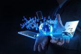 Businessman shows modern technology — Stock Photo