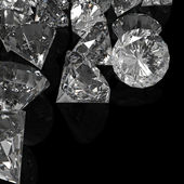 Diamonds isolated on black surface — Stock Photo