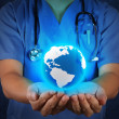 Medical Doctor holding a world globe in his hands as medical net — Stock Photo
