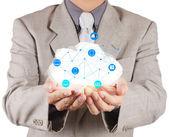 Zakenman die werken met een cloud computing diagram — Stockfoto