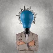 Businessman and light bulb head and traveling around the world — Stock Photo