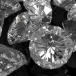 Stock Photo: Diamonds on black surface