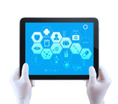 Medicine doctor hand shows tablet compuer with medical computer — Stock Photo
