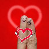 το ζευγάρι χαρούμενος δάχτυλο ερωτευμένος με ζωγραφισμένο γελαστά — Φωτογραφία Αρχείου