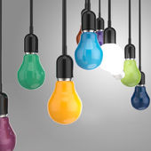 Creative idea and leadership concept colors light bulb — Stock Photo