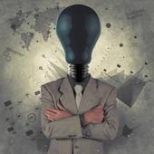 Businessman with blue light bulb head as concept — Stock Photo