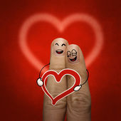 The happy finger couple in love with painted smiley — Stock Photo