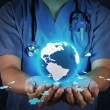 Medical Doctor holding a world globe in his hands as medical net — Stock Photo #27772511