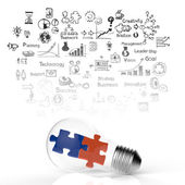 Light bulb and puzzle piece as ideas — Stock Photo