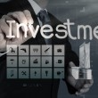 Businessman pointing to investment concept — Stock Photo