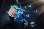 Businessman pressing modern social buttons on a virtual — Foto de Stock