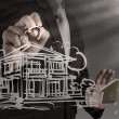 Businessman draws building development — Foto de Stock
