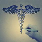 Doctor hand draws Caduceus — Stock Photo