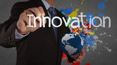 Businessman hand writing innovation on splash color background — Stock Photo