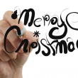Female hand draw merry christmas — Stockfoto