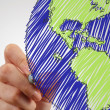 Female hand drawing earth — Stock Photo