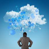 Empresario con signo como colores de chapoteo de computación en nube un — Foto de Stock