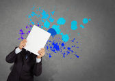 Businessman with blank book and splash colors choice — Stock Photo