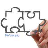 Female Hand drawing Partnership Puzzle — Stock Photo