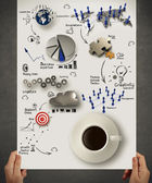 Hand holding 3d coffee cup on business strategy diagram — Stok fotoğraf