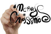 Female hand draw merry christmas — Stock Photo