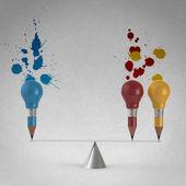 False balance of pencil lightbulb and splash colors background — Stock Photo