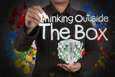Thinking outside the box and splash colors — Stock Photo