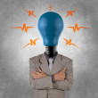 Businessman with lamp-head — Stock Photo